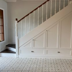 Handmade Tulle encaustic tile, with its intricate design and neutral colour scheme, entrance. Rever Tiles.