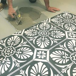 Handmade HOJA encaustic tile of old Spanish design in gunmetal blue and white has a laid-back, casual vibe - bathroom floor installation - Rever Tiles.