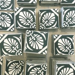 Handmade HOJA encaustic tile of old Spanish design in gunmetal blue and white has a laid-back, casual vibe - bathroom floor pre-installation - Rever Tiles.