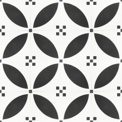 Our Handmade PETAL encaustic tile is a simple take on the ever-popular Corolla encaustic tile. With French flair and a timeless black and white scheme this sophisticated design allows for a unique look that's both warm and contemporary. Floor view - Rever Tiles.