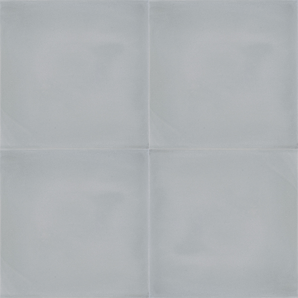 Handmade PLATA encaustic tile, a versatile mid-grey solid colour tile that pairs beautifully with a wide range of other colours. Four tile view - Rever Tiles.