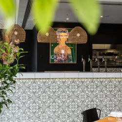 Our exclusive Orsola-3 encaustic tile is indeed special. An 1880's design, Orsola with its graceful curves offers a sophisticated sensibility. Restaurant bar installation - Rever Tiles.