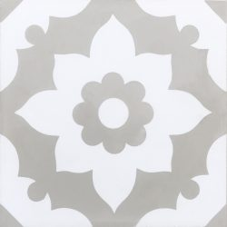 Our Santona encaustic tile in soft transitional grey is a delightful bathroom floor tile that will elevate your space from ho-hum to decadent as a day spa. Single tile view - Rever Tiles.